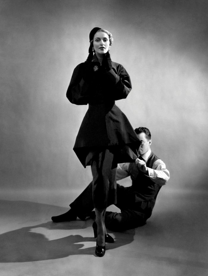 Designer Charles James pinning a suit on model (possibly Ricki Van Dusen)  Outstanding Houte-couture Fashion Exhibition at The Metropolitan, New York Outstanding Houte couture Fashion Exhibition at The Metropolitan New York Charles James with Model 1948